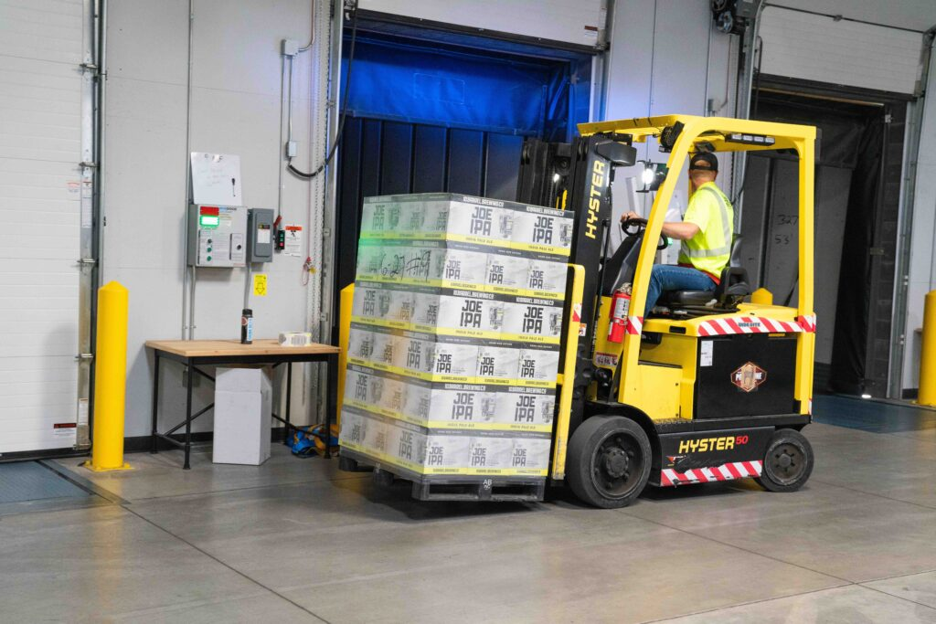 forklift driver carrying cargo